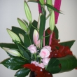 Arrangement with Lillies and foliage